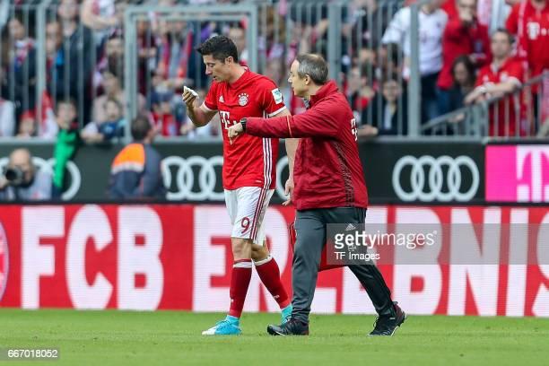Robert Lewandowski and Dr Volker Braun looks on during the Bundesliga match between Bayern Muenchen and Borussia Dortmund at Allianz Arena on April 8...