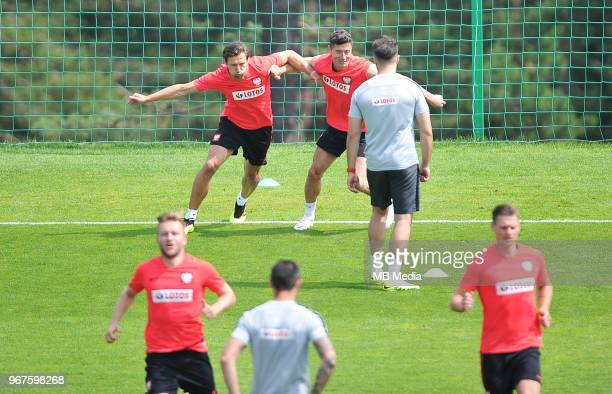Robert Lewandowski and Grzegorz Krychowiak of Poland during a training session of the Polish national team at Arlamow Hotel during the second phase...
