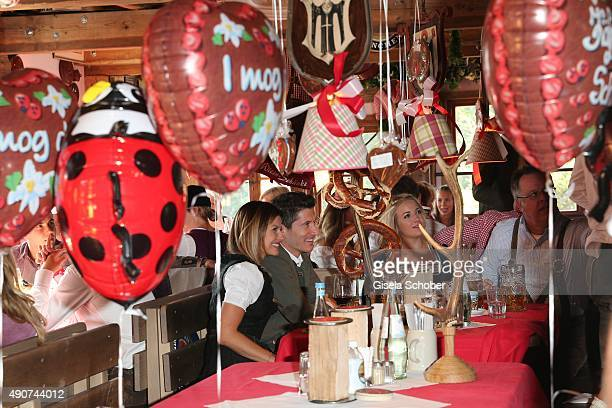 Robert Lewandowski and his partner Anna Stachurska attend the 'FC Bayern Muenchen Wiesn' during Oktoberfest 2015 at Kaeferschaenke on September 30...