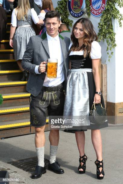 """Robert Lewandowski and his wife Anna Lewandowski during the """"FC Bayern Wies'n"""" as part of the Oktoberfest at Theresienwiese on September 23, 2017 in..."""