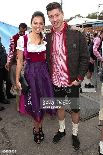 Robert Lewandowski and his wife Anna Stachurska attend the FC Bayern Wies'n during Oktoberfest at Kaeferzetl/Theresienwiese on October 5 2014 in...