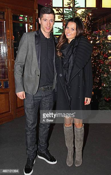 Robert Lewandowski and his wife Anna Stachurska attend the FC Bayern Muenchen Christmas Party at Schuhbeck's Teatro restaurant on December 7 2014 in...