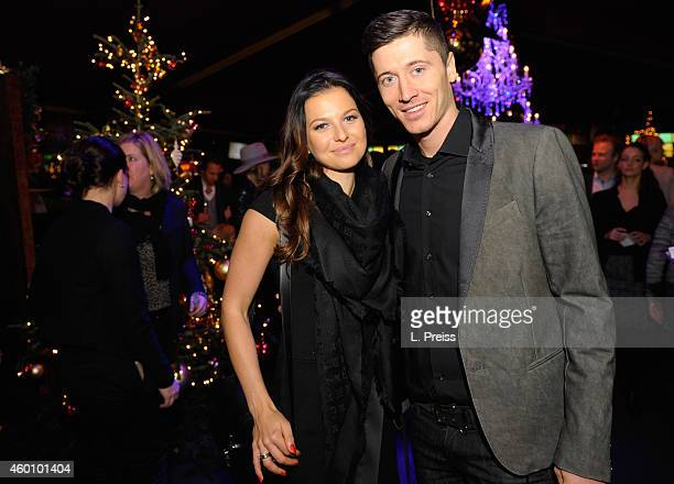 Robert Lewandowski and his wife Anna Stachurska attend the FC Bayern Muenchen Christmas Party at Schubeck's Teatro restaurant on December 7 2014 in...