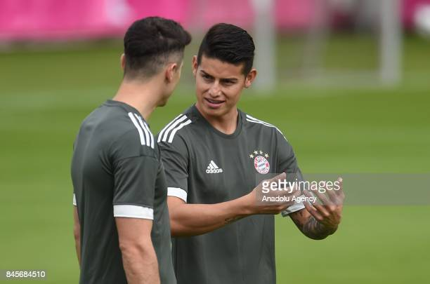 Robert Lewandowski and James Rodriguez of Bayern Munich are seen at the beginning of a training session at the Team's Training Compound in Munich...