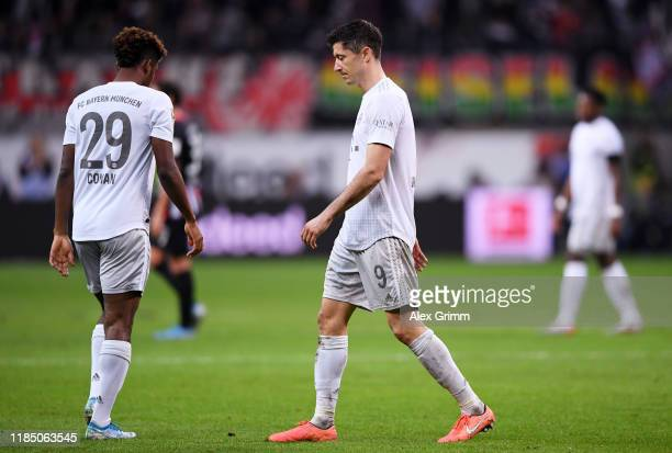 Robert Lewandowski and Kingsley Coman of FC Bayern Munich react during the Bundesliga match between Eintracht Frankfurt and FC Bayern Muenchen at...