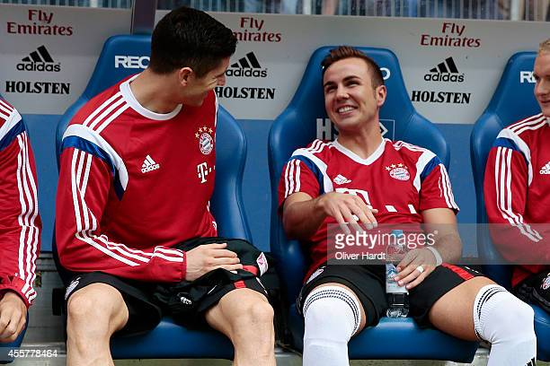 Robert Lewandowski and Mario Goetze of Munich on the bench before the Bundesliga match between Hamburger SV and FC Bayern Muenchen at Imtech Arena on...