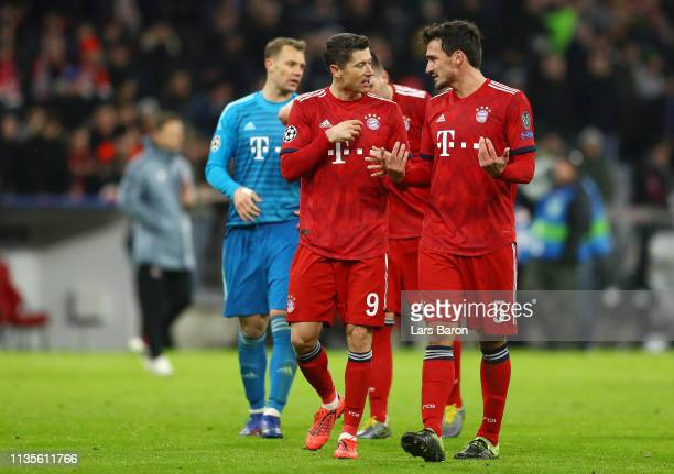 Robert Lewandowski and Mats Hummels of Bayern Munich in discussion after defeat in the UEFA Champions League Round of 16 Second Leg match between FC...