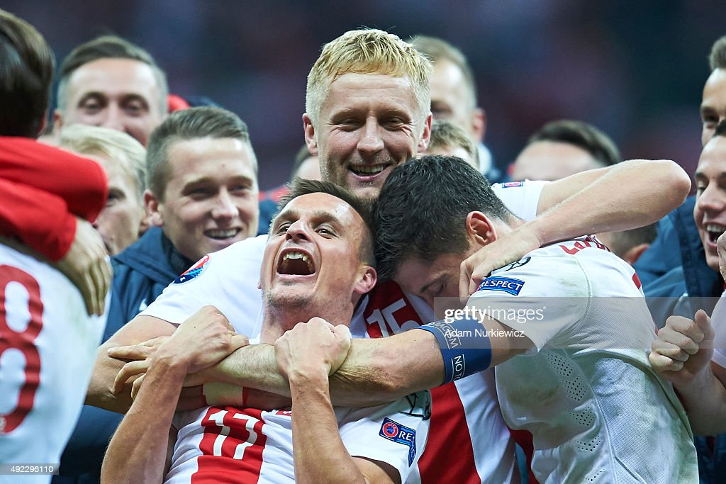 Robert Lewandowski and Slawomir Peszko and Kamil Glik all from Poland celebrate after the UEFA EURO 2016 qualifying match between Poland and Republic of Ireland at National Stadium on October 11, 2015 in Warsaw, Poland.