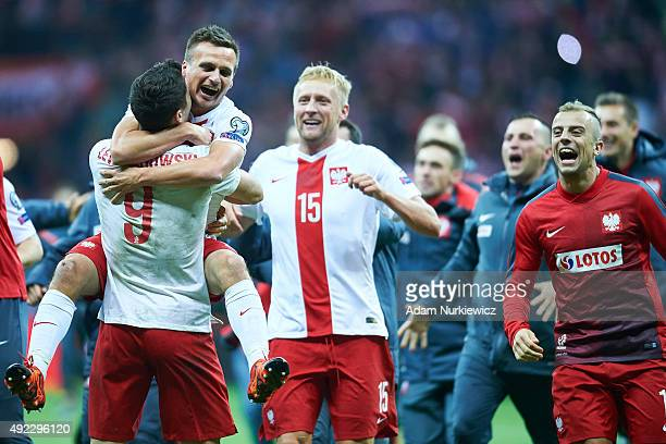 Robert Lewandowski and Slawomir Peszko and Kamil Glik and Kamil Grosicki all from Poland celebrate after the UEFA EURO 2016 qualifying match between...