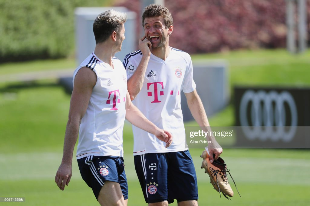 Robert Lewandowski and Thomas Mueller laugh after a training session on day 5 of the FC Bayern Muenchen training camp at ASPIRE Academy for Sports Excellence on January 6, 2018 in Doha, Qatar.