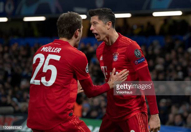 Robert Lewandowski and Thomas Muller of FC Bayern Munchen celebrate the first goal during the UEFA Champions League round of 16 first leg match...