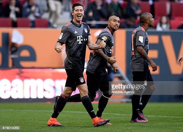 Robert Lewandowski Arturo Vidal and Douglas Costa of Bayern Munich celebrate after scoring a goal during the Bundesliga soccer match between FC...