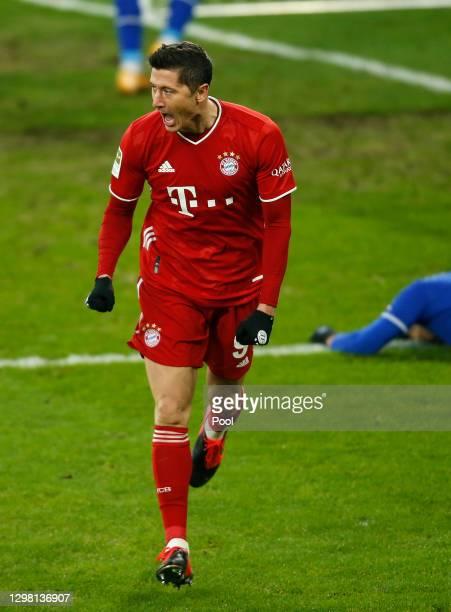 Robert Lewandowski celebrates after scoring their sides second goal during the Bundesliga match between FC Schalke 04 and FC Bayern Muenchen at...