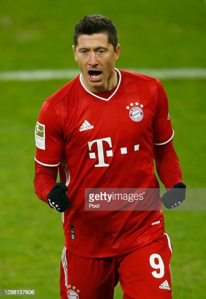 Robert Lewandowski celebrates after scoring their sides second goal during the Bundesliga match between FC Schalke 04 and FC Bayern Muenchen at...