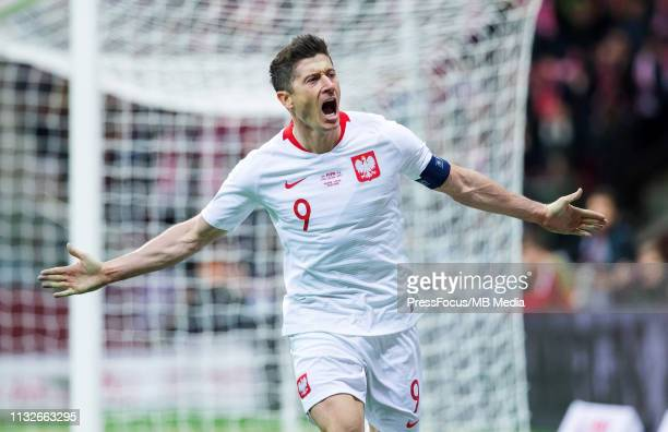Robert Lewandowski celebrates scoring a goal during the 2020 UEFA European Championships group G qualifying match between Poland and Latvia at...