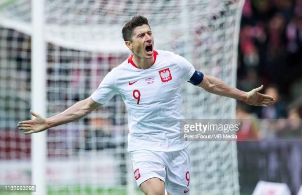 Robert Lewandowski celebrates scoring a goal during the 2020 UEFA European Championships group G qualifying match between Poland and Latvia at...