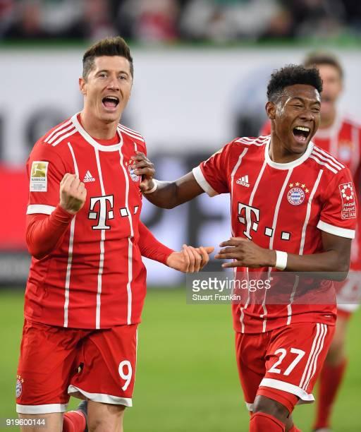 Robert Lewandowski celebrates scoring the second goal with David Alaba of Muenchen during the Bundesliga match between VfL Wolfsburg and FC Bayern...