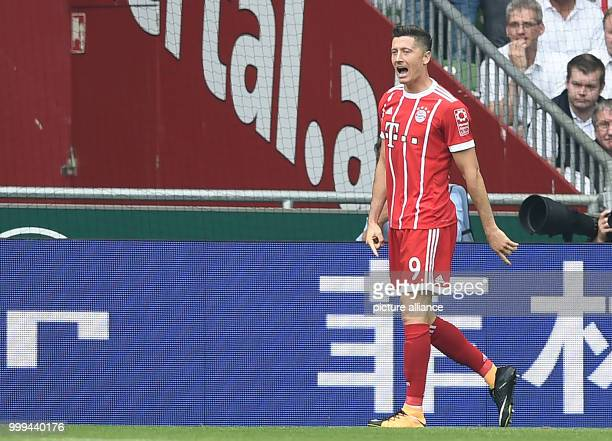 Robert Lewandowski cheers over his 01 score during the Bundesliga soccer match between Werder Bremen and Bayern Munich at the Weserstadion in Bremen...