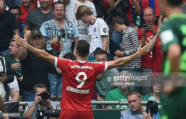 Robert Lewandowski cheers over his 02 score during the Bundesliga soccer match between Werder Bremen and Bayern Munich at the Weserstadion in Bremen...