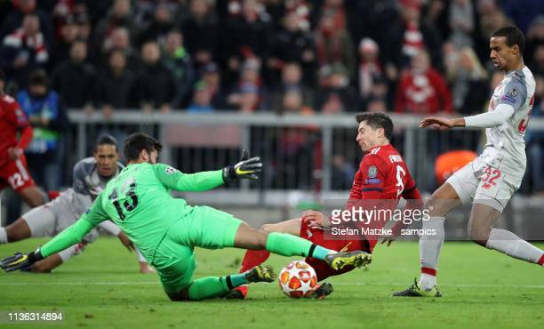 Robert Lewandowski FC Bayern München Alisson FC Liverpool during the UEFA Champions League Round of 16 Second Leg match between FC Bayern Muenchen...