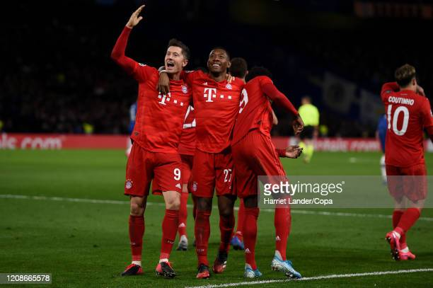 Robert Lewandowski FC Bayern Munich celebrates with teammates after scoring his team's third goal during the UEFA Champions League round of 16 first...