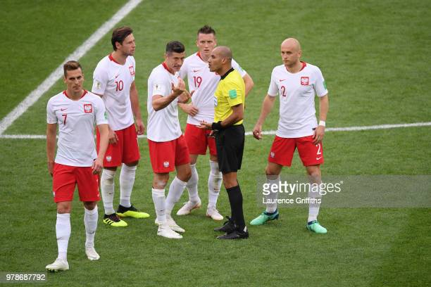Robert Lewandowski Grzegorz Krychowiak and Piotr Zielinski of Poland argue with Referee Nawaf Shukralla during the 2018 FIFA World Cup Russia group H...