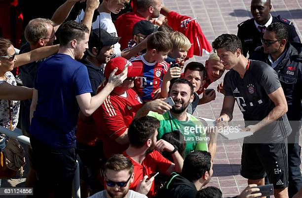 Robert Lewandowski is seen with fans after a training session at day 5 of the Bayern Muenchen training camp at Aspire Academy on January 7 2017 in...