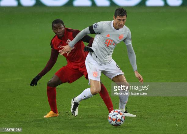 Robert Lewandowski is tackled by Mohamed Camara of RB Salzburg during the UEFA Champions League Group A stage match between RB Salzburg and FC Bayern...