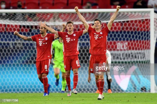 Robert Lewandowski, Joshua Kimmich and Javi Martinez of Bayern Munich celebrate following their sides victory in the UEFA Super Cup match between FC...