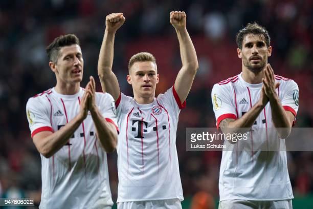 Robert Lewandowski Joshua Kimmich and Javi Martinez of Munich celebrate after winning the DFB Cup semi final match between Bayer 04 Leverkusen and...