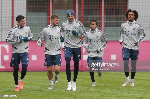 Robert Lewandowski Lars Lukas Mai Leon Goretzka Sarpreet Singh and Joshua Zirkzee of FC Bayern Muenchen warm up during a training session at Saebener...