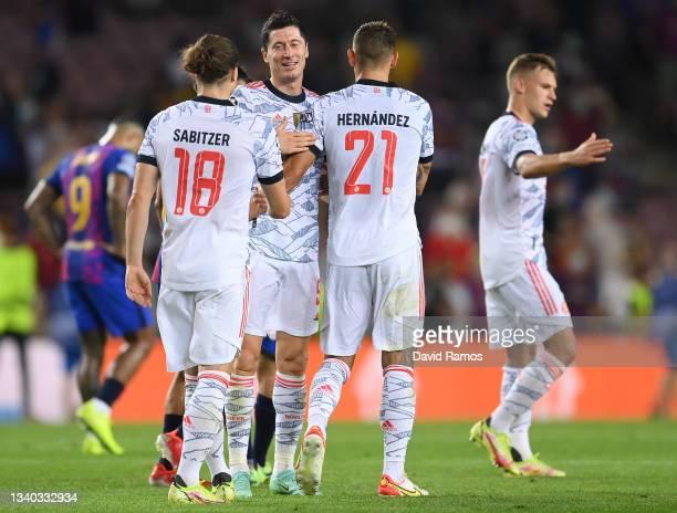 Robert Lewandowski, Lucas Hernandez and Marcel Sabitzer of Bayern Munich interact following the UEFA Champions League group E match between FC...