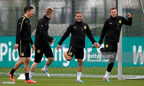 Robert Lewandowski Marco Reus Mario Goetze and Kevin Grosskreutz warm up during a Borussia Dortmund training session ahead of their UEFA Champions...