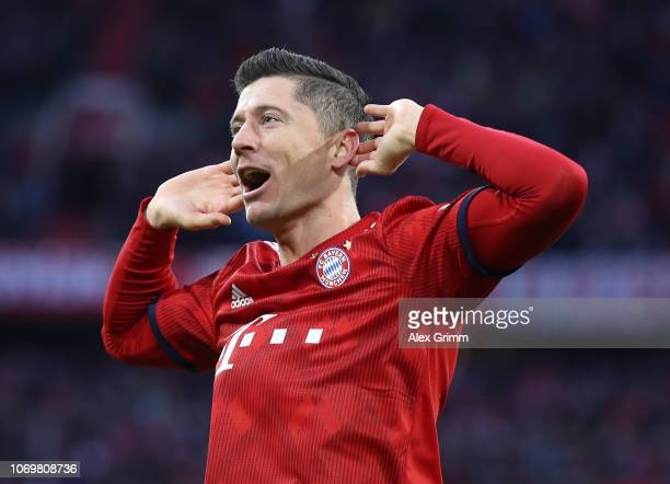 Robert Lewandowski of Bayer Munich celebrates after scoring his tam's first goal during the Bundesliga match between FC Bayern Muenchen and 1 FC...