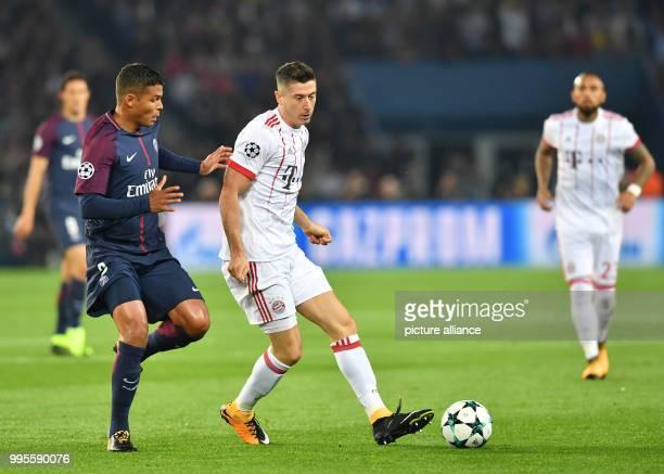 Robert Lewandowski of Bayern and Thiago Silva of Paris vie for the ball during the Champions League football match between Paris St Germain and...