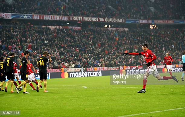 Robert Lewandowski of Bayern celebrates after he scores the opening goal during the UEFA Champions League match between FC Bayern Muenchen and Club...
