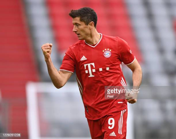 Robert Lewandowski of Bayern celebrates after scorng his sides first goal during the Bundesliga match between FC Bayern Muenchen and Eintracht...