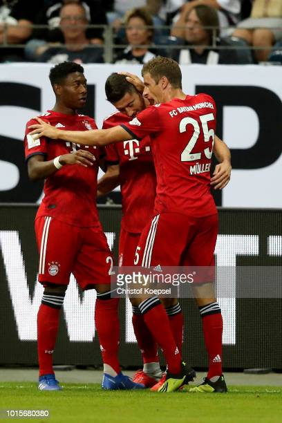 Robert Lewandowski of Bayern celebrates the first goal with David Alaba and Thomas Mueller of Bayern during the DFL Supercup match between Eintracht...