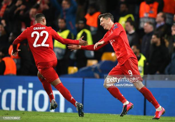 Robert Lewandowski of Bayern celebrates the third goal with Serge Gnabry during the UEFA Champions League round of 16 first leg match between Chelsea...