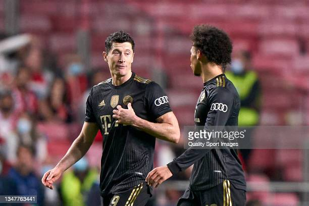 Robert Lewandowski of Bayern München talks with Leroy Sane of Bayern München during the UEFA Champions League group E match between SL Benfica and...