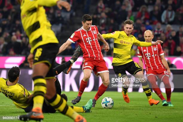 Robert Lewandowski of Bayern Muenchen about to score a goal to make it 60 during the Bundesliga match between FC Bayern Muenchen and Borussia...