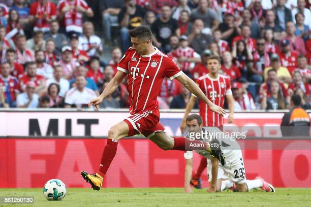 Robert Lewandowski of Bayern Muenchen about to score his teams fourth goal to make it 40 during the Bundesliga match between FC Bayern Muenchen and...