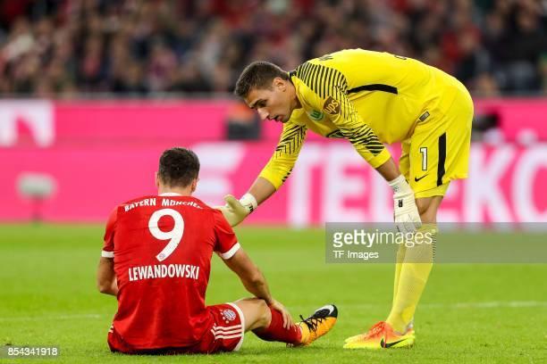 Robert Lewandowski of Bayern Muenchen am Boden Goalkeeper Koen Casteels of Wolfsburg looks on during the Bundesliga match between FC Bayern Muenchen...