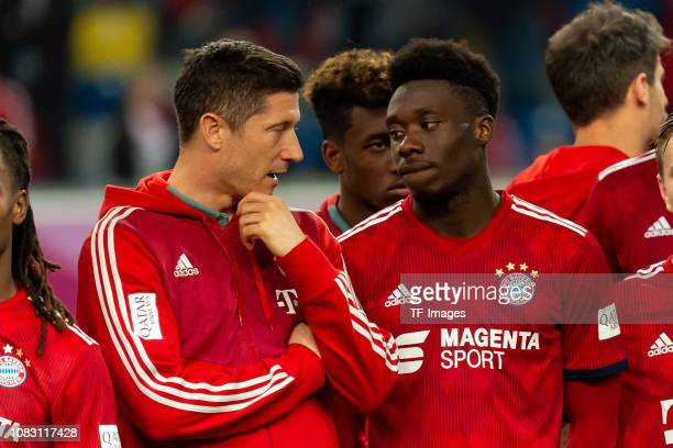 Robert Lewandowski of Bayern Muenchen and Alphonso Davies of Bayern Muenchen after winning the Telekom Cup 2019 Final between FC Bayern Muenchen and...
