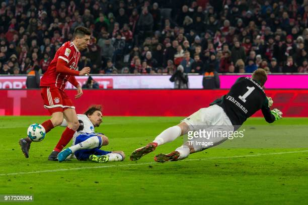 Robert Lewandowski of Bayern Muenchen and Benjamin Stambouli of Schalke battle for the ball during the Bundesliga match between FC Bayern Muenchen...