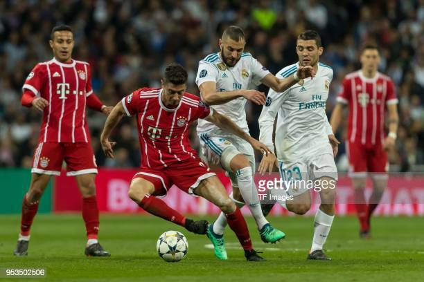 Robert Lewandowski of Bayern Muenchen and Karim Benzema of Real Madrid battle for the ball during the UEFA Champions League Semi Final Second Leg...