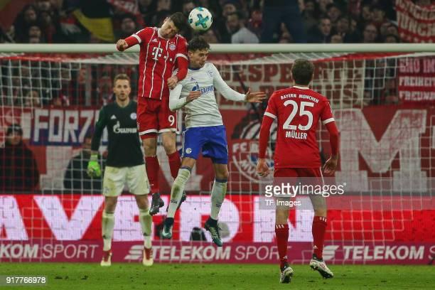 Robert Lewandowski of Bayern Muenchen and Leon Goretzka of Schalke battle for the ball during the Bundesliga match between FC Bayern Muenchen and FC...