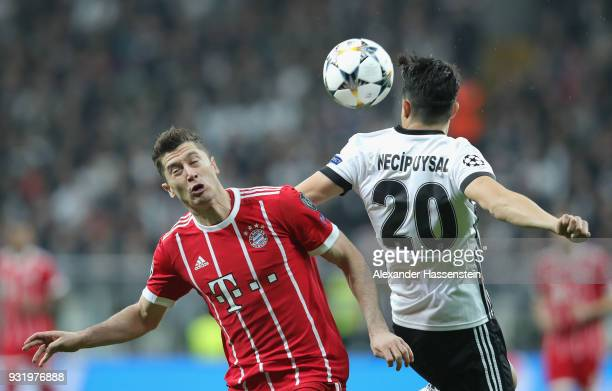 Robert Lewandowski of Bayern Muenchen and Necip Uysal of Besiktas battle for the ball during the UEFA Champions League Round of 16 Second Leg match...