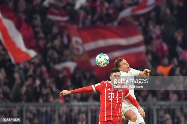 Robert Lewandowski of Bayern Muenchen and Niklas Moisanderof Bremen jump for a header during the Bundesliga match between FC Bayern Muenchen and SV...