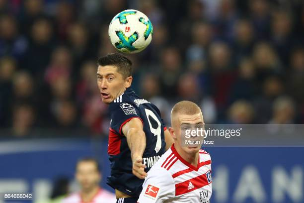 Robert Lewandowski of Bayern Muenchen and Rick van Drongelen of Hamburg during the Bundesliga match between Hamburger SV and FC Bayern Muenchen at...
